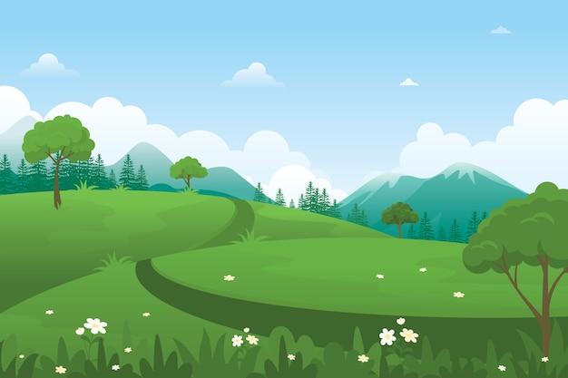 緑の丘を横切る小道のある自然の風景