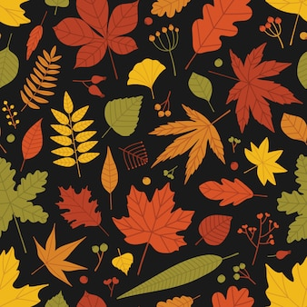 Natural seamless pattern with fallen leaves and berries scattered on black background. bright colored autumn backdrop. illustration in flat style for wrapping paper, wallpaper, fabric print.