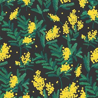 黒の背景にゴージャスな咲くミモザの花と自然なシームレスパターン。