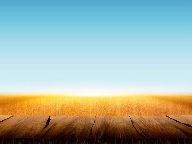 Естественный фон поля пшеницы с пустым деревянным столом