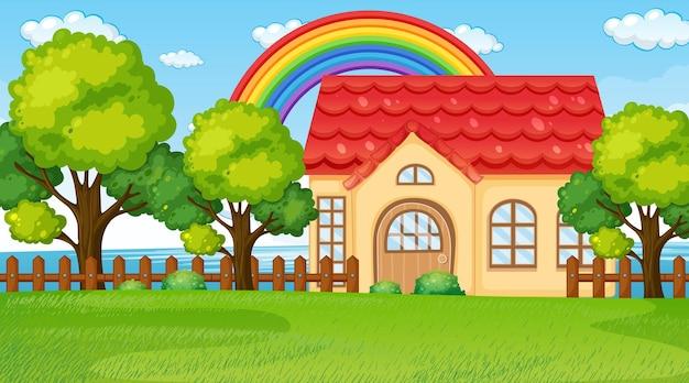 Сцена пейзажа природы с домом и радугой в небе