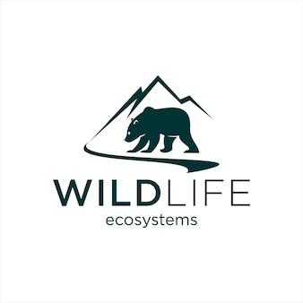 Логотип природы с горой и рекой также вектор медведя гризли