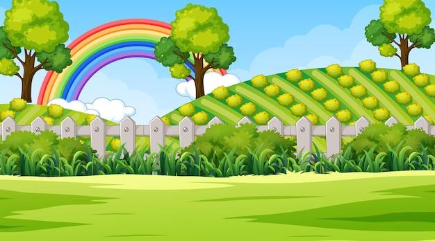 空に虹と自然公園のシーンの背景