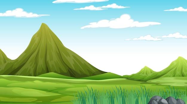 牧草地の風景と山と昼間の自然シーン