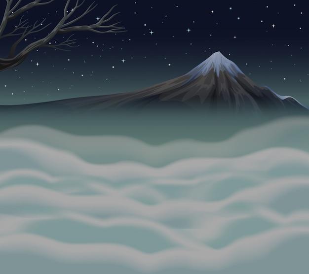 Nature scene with fog on the mountain peak