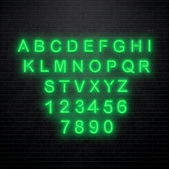 Neon alphabet isolated on brick wall