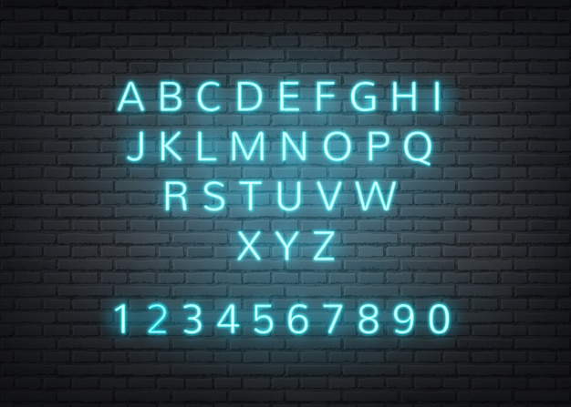 Neon alphabet retro letters on brick wall