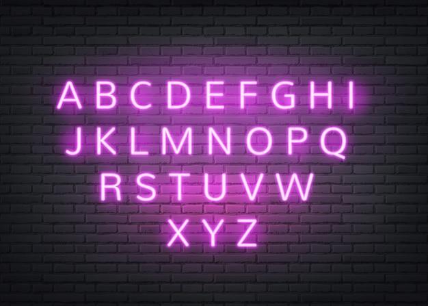 レンガの壁にネオンアルファベットレトロな文字