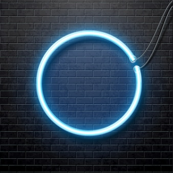 Neon blue circle isolated on black brick wall