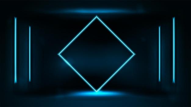 ぼやけた背景の暗い部屋の壁にラインネオンランプとネオンブルーダイヤモンド形フレーム