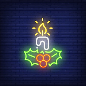 Neon candle and mistletoes. Festive element. Christmas concept