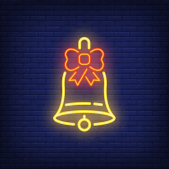 Neon christmas bell with bow. festive element. celebration concept