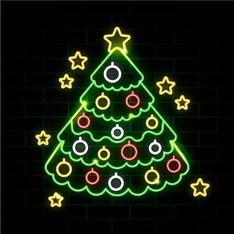 Neon christmas tree on a brick wall