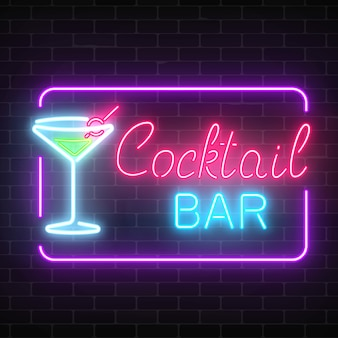 Neon cocktail bar and cafe glowing sign with geometrical frame on a brick wall .