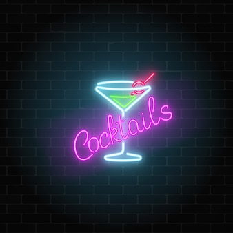 Neon cocktails bar or cafe sign on dark brick wall background