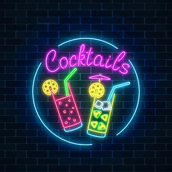 Neon cocktails bar sign in circle frame on dark brick wall background. glowing gas advertising.