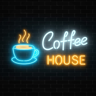Neon coffee house signboard on a dark brick wall . hot drink and food cafe sign.