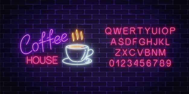 Neon coffee house signboard with alphabet on a dark brick wall