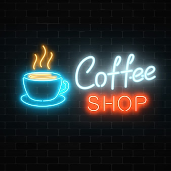 Neon coffee shop signboard on a dark brick wall . hot drink and food cafe sign.