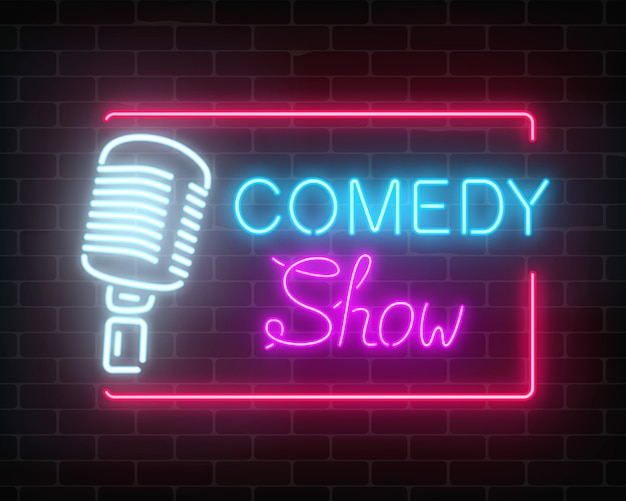 Neon comedy show sign with retro microphone on a brick wall