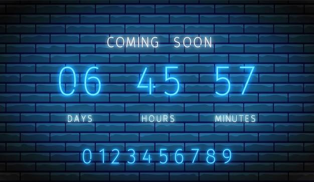 ネオンカウントダウンタイマー。時計カウンター。図。レンガの壁に輝くスコアボード。