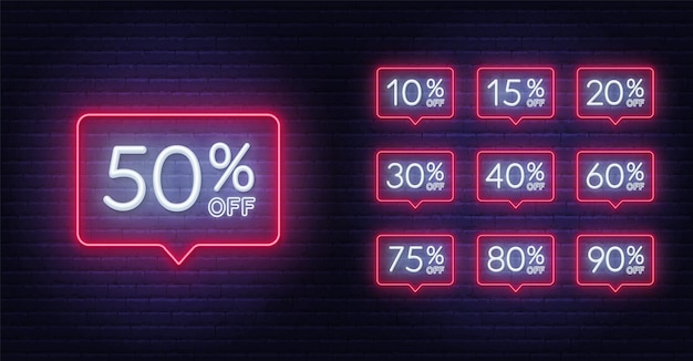 Neon discount light signs on a dark background.