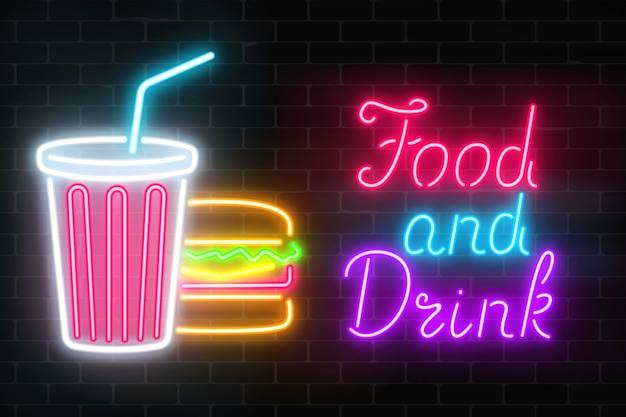 Neon food and drink glowing signboard on a dark brick wall