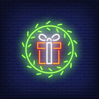 Neon gifts in fur wreath. Night bright advertisement element.