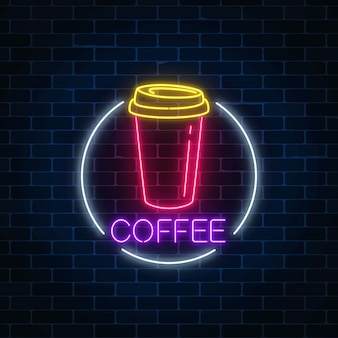 Neon glowing sign of coffee cup in circle frame on a dark brick wall