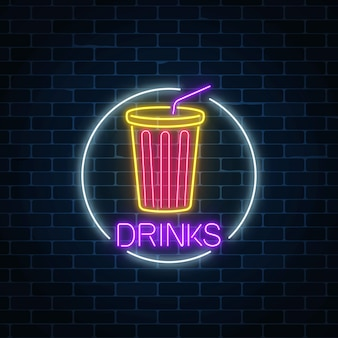 Neon glowing sign of cold soda drink in circle frame on a dark brick wall