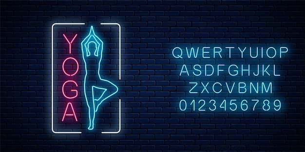 Neon glowing sign of yoga exercices in rectangle frame with alphabet. street advertising signboard of gymnastics club.