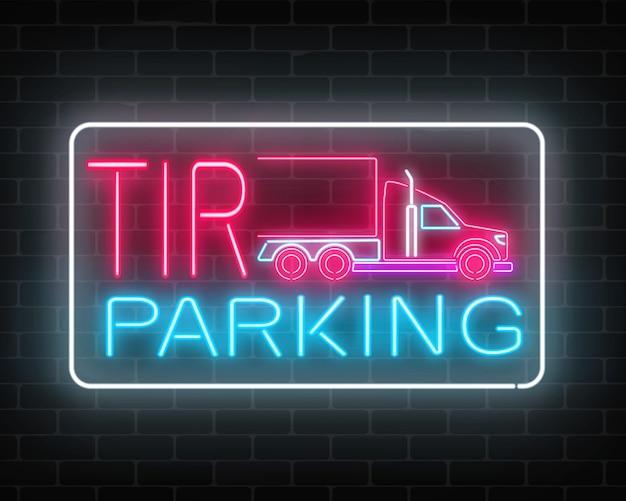 벽돌 벽에 네온 빛나는 Tir 주차 사인 긴 차량 트럭 및 트럭의 광선 간판입니다. 프리미엄 벡터