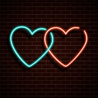 Neon heart. a bright red and blue sign.