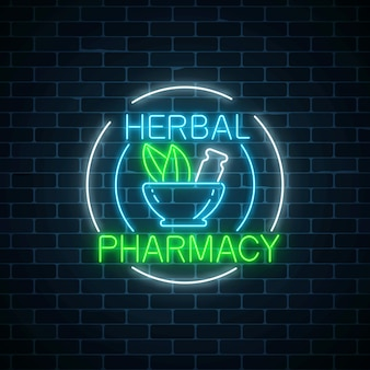 Neon herbal pharmacy sign in circle frames on dark brick wall background. 100 percent natural medicaments store.
