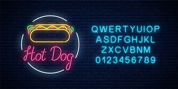Neon hot dog cafe glowing signboard on a dark brick wall