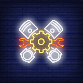 Neon icon of mechanic tools and pedals