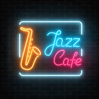 Neon jazz cafe and saxophone glowing sign on a dark brick wall .