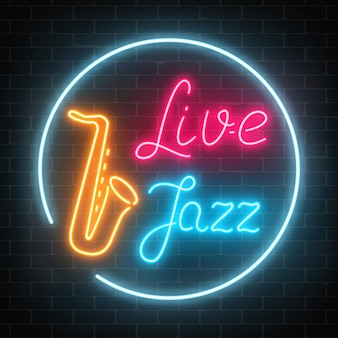 Neon jazz cafe with live music and saxophone glowing sign on a dark brick wall .