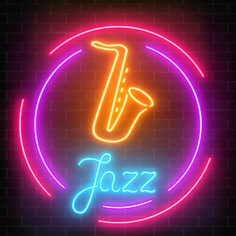 Neon jazz cafe with saxophone glowing sign with round frame on a dark brick wall .