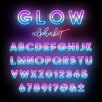 Neon light alphabet. multicolor glowing typeface.