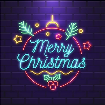 Neon merry christmas text with decorations Premium Vector