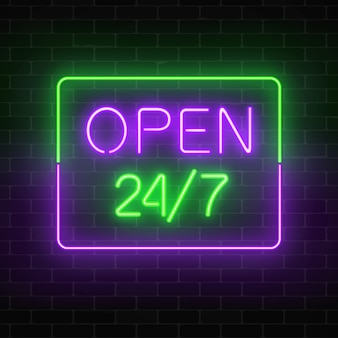 Neon open 24 hours 7 days a week sign in rectangle shape on a brick wall