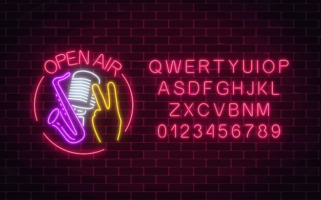 Neon open air sign with microphone, saxophone and piece gesture in round frame with alphabet.