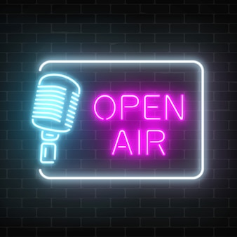 Neon open air signboard with microphone in restangle. nightclub with live speaking concert icon.