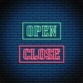 Neon open and close text glowing bright signboard in rectangle frames.
