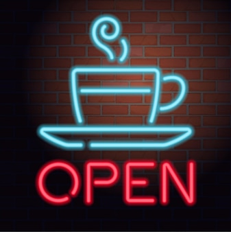 Neon open sign on brick wall