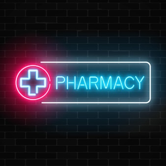 Neon pharmacy glowing signboard on brick wall illuminated drugstore sign open 24 hours.