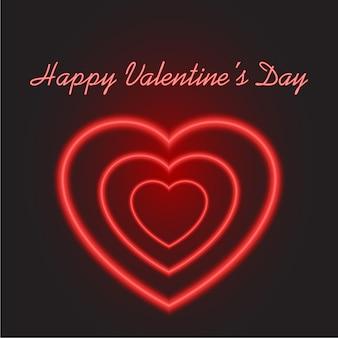 黒の背景にバレンタインデーのネオン赤いハート。