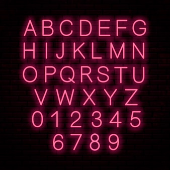 Neon red letters isolated on wall .  glowing font. english alphabet.