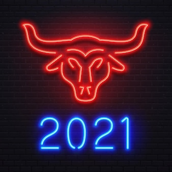 Neon red ox for 2021 new year greeting card. bright blue letters 2021 sign, bar or cafe signboard, light banner. logo bull for holiday celebration. cow symbol on brick wall vector illustration